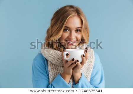 Image of cute woman 20s wrapped in scarf smiling and holding cup Stock photo © deandrobot