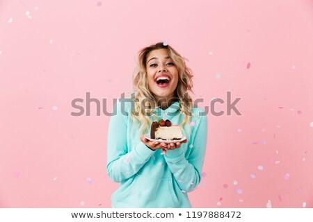 Nő pózol izolált rózsaszín fal tart Stock fotó © deandrobot