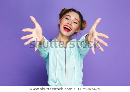Image of caucasian woman with two buns laughing and reaching out Stock photo © deandrobot