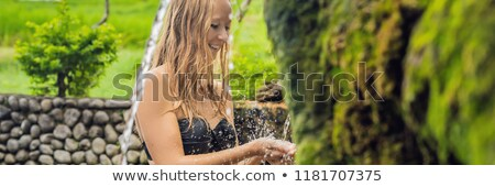 Young woman tourist in Belulang Hot Springs in Bali on the background of rice terraces BANNER, long  Stock photo © galitskaya