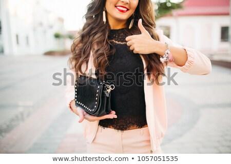 Belle fille heureuse mode noir sac à main Photo stock © studiolucky
