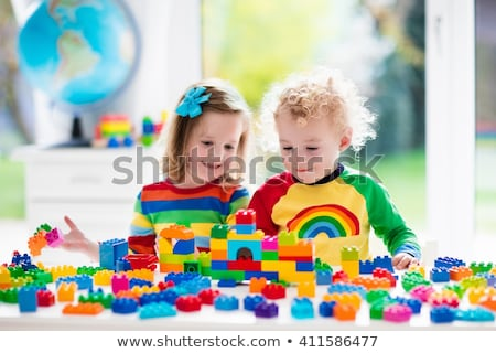 The preschoolers group in kindergarten together, Nursery group play with block , Foto stock © Lopolo