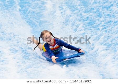 Kinderen leren zwemmen surfen lichaam boord Stockfoto © dashapetrenko