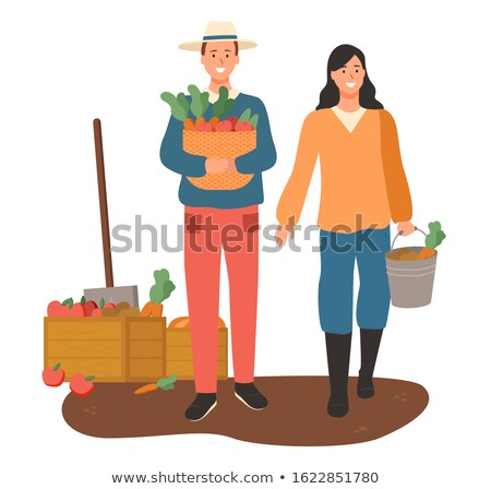 Woman on Plantation Carrying Harvested Veggies Stock photo © robuart