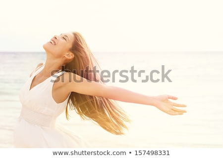 Portrait Of Beautiful Young Woman Relaxing On Beach Stock photo © monkey_business