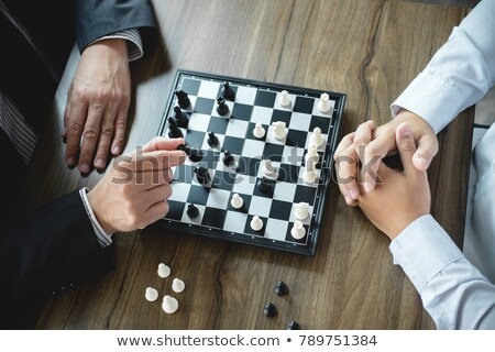 Stock photo: Confident businessman colleagues playing chess game overcome the