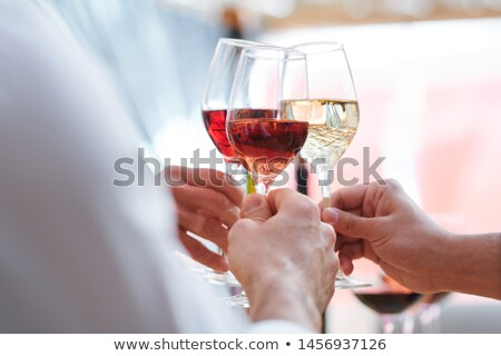 human hands holding wineglasses with champagne cabernet and brandy stock photo © pressmaster