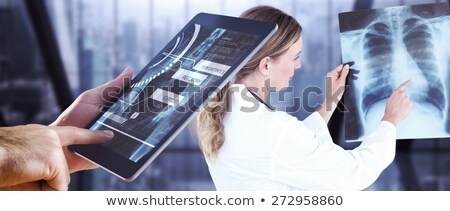 Side view of Caucasian male doctor using digital tablet in a conference room Stock photo © wavebreak_media