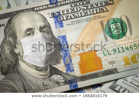 One Hundred Dollar Bill With Medical Face Mask on Face of Benjam Stock photo © feverpitch