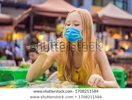 Mutlu sevimli tıbbi maske yeme sokak gıda Stok fotoğraf © galitskaya