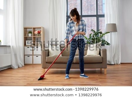 asian woman with broom sweeping floor and cleaning Stock photo © dolgachov