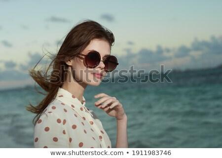 Jeunes brunette femme lit blanche Photo stock © stryjek