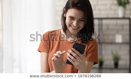 telefoon · onderhandelingen · jonge · ondernemer · naar · camera - stockfoto © stockyimages