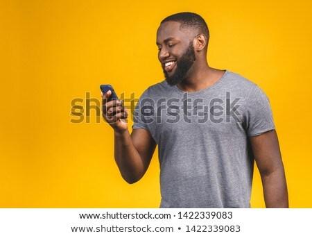 happy young teenager on his mobile phone stock photo © zurijeta