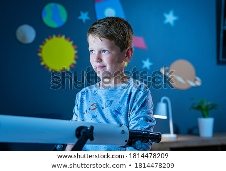 A happy astronaut in the sky Stock photo © bluering