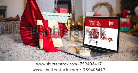 Gift sack, gift and laptop placed together on rug Stock photo © wavebreak_media