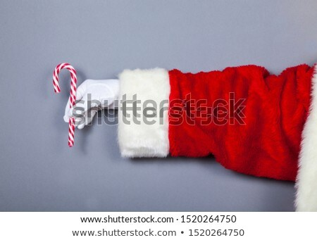 santa claus holding a candy cane isolated on white christmas bac stock photo © nikodzhi