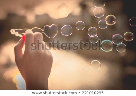 Pár buborékfújás férfi ajtó városi férfi Stock fotó © IS2