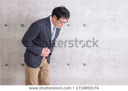 Gray Suit Businessman Bad condition_sickness Stock photo © toyotoyo