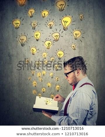 üzletember tart olvas kinyitott könyv izzó Stock fotó © ichiosea