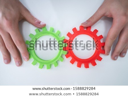 Businessperson Joining Gears On Desk Stock photo © AndreyPopov