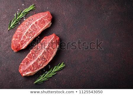 nyers · felső · penge · steak · főzés · vágódeszka - stock fotó © karandaev