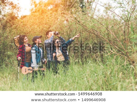 Carefree relaxed friendly family walk on road in countryside wit Stock photo © vkstudio