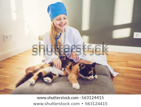 Happy smiling little girl holding a stethoscope Stock photo © Giulio_Fornasar