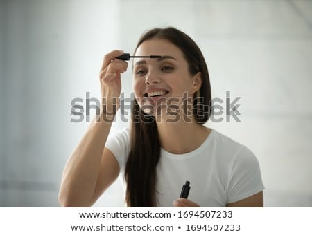 Young beautiful woman applying makeup Stock photo © rosipro