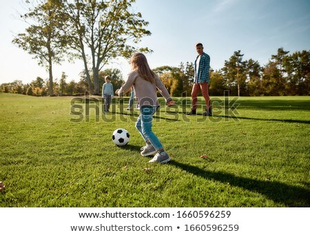little girl playing with green ball in the park stock photo © hasloo
