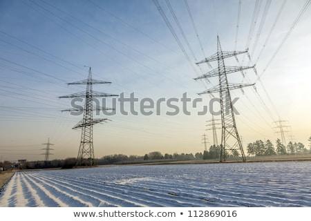 высокий · закат · зима · силуэта · электрических · высокое · напряжение - Сток-фото © meinzahn