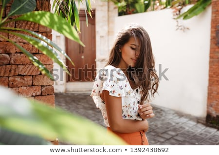 Beautiful Girl with Hibiscus in Her Hair Stock photo © feverpitch