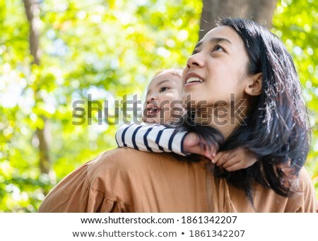 daughter lies at mother on  back in spring park Stock photo © Paha_L