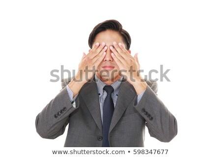 Businessman covering his eyes Stock photo © wavebreak_media