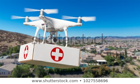 Unmanned Aircraft System (UAV) Quadcopter Drone Delivering Box W Stock photo © feverpitch