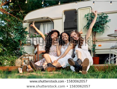 Feliz meninas brasão posando Foto stock © GVS