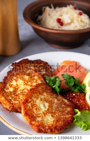 Potato pancakes with salmon and caviar in luxury restaurant, food and cuisine Stock photo © Anneleven