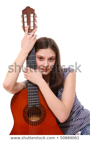 Serious woman hugging her guitar Stock photo © photography33