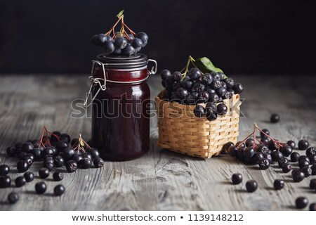Black chokeberry jam on wooden table Stock photo © inxti