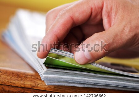 the hand through the pages of the magazine Stock photo © mizar_21984