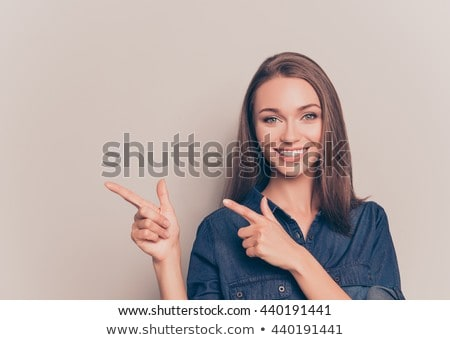 woman gesturing and smiling stock photo © imagedb