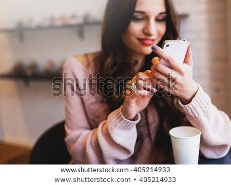 Csinos álmodik lány ül kávézó asztal Stock fotó © deandrobot