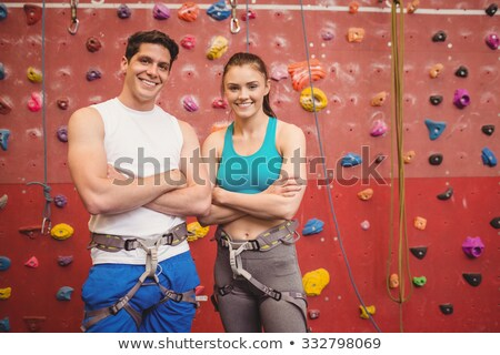 Portrait of smiling man with female athlete climbing rock Stock photo © wavebreak_media