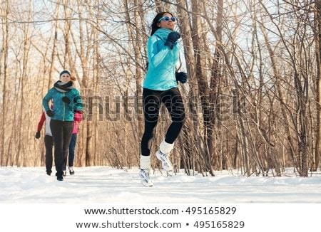 Grupy znajomych jogging śniegu zimą Zdjęcia stock © Lopolo