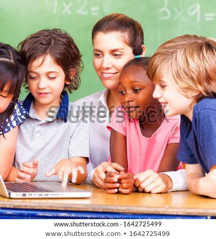 A portrait of a teacher and children Stock photo © IS2