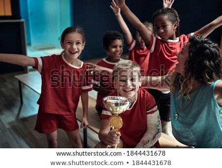Young children sitting on benches and yelling Stock photo © monkey_business