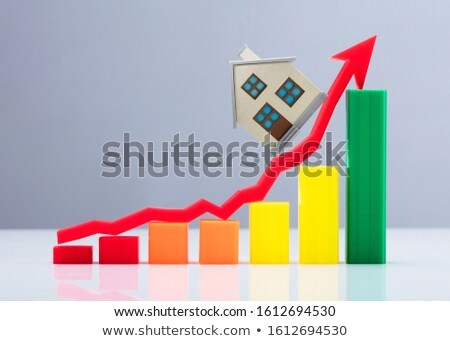 Increasing Graph And Arrow Sign With House Model Over Desk Stock photo © AndreyPopov