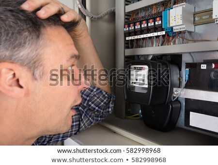 Shocked Man Looking At Meter Stock photo © AndreyPopov