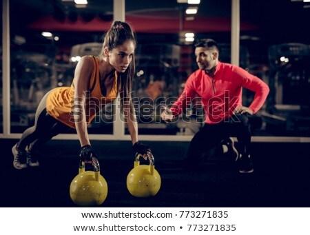 Strong Muscular Couple Kneeling On The Floor Stock photo © Jasminko