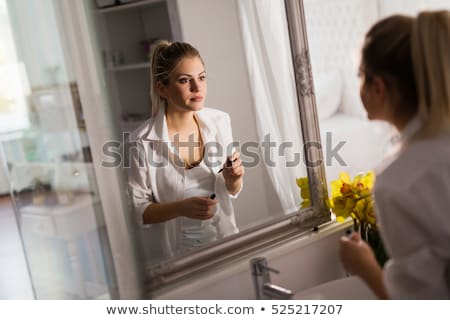 Woman Looking In The Mirror And Applying Lipstick Stock photo © stuartmiles
